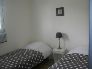 A bed or beds in a room at Gite Mont St Michel