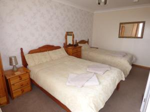 A bed or beds in a room at Jasmine house bed & breakfast