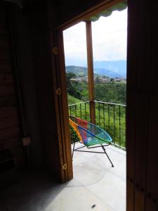 A balcony or terrace at Gallito de las Rocas Guest House