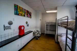 A bunk bed or bunk beds in a room at Wicked Hostels - Calgary
