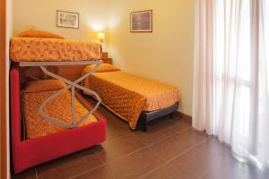 A bunk bed or bunk beds in a room at Hotel Taormina