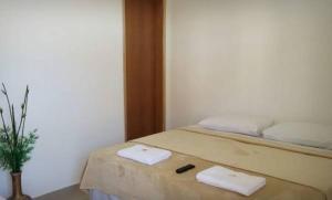 Cama ou camas em um quarto em Hospedagem de Jesus