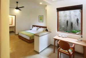 A bed or beds in a room at Moss BnB Colombo