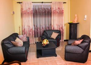 The lounge or bar area at Shalona Holiday Home
