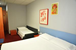 A bed or beds in a room at Hotel Cappello Di Ferro