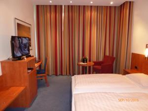 Ein Bett oder Betten in einem Zimmer der Unterkunft Astoria Hotel