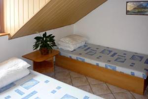 Posteľ alebo postele v izbe v ubytovaní Ranč Nádej