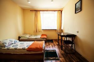 Łóżko lub łóżka w pokoju w obiekcie Kremenaros