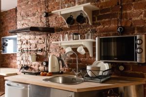 Кухня или мини-кухня в New Horizon on Gromovoy