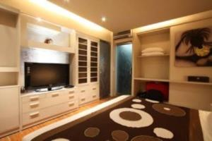 A television and/or entertainment centre at Sejuk Suites
