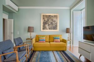 A seating area at Chiado Camões Apartments | Lisbon Best Apartments