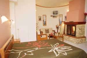Ένα ή περισσότερα κρεβάτια σε δωμάτιο στο Ξενώνας Ίριδα