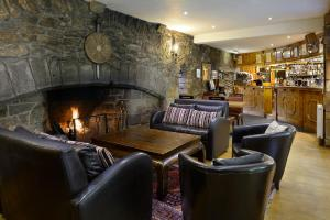 The lounge or bar area at Dornoch Castle Hotel