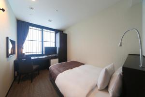 京都塔酒店房間的床