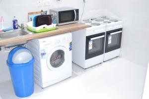 A kitchen or kitchenette at Egali accommodation Malta