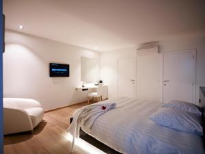 Een bed of bedden in een kamer bij B&B Aquabello