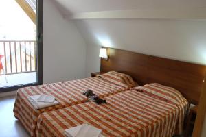 Un ou plusieurs lits dans un hébergement de l'établissement Résidence Mer & Golf Tourmalet