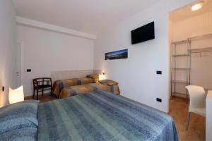 A bed or beds in a room at B&B Villa Giuli