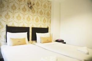 Una habitación en Erawan House