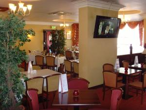 A restaurant or other place to eat at Villa Hotel