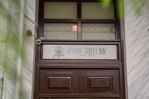 The facade or entrance of Athinas Street Inn