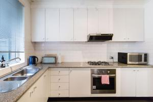 A kitchen or kitchenette at Selena - Beyond a Room Private Apartments