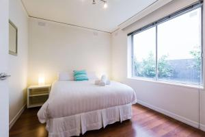 A bed or beds in a room at Selena - Beyond a Room Private Apartments