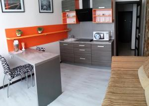 A kitchen or kitchenette at Apartments at Bulvar Pobedy