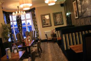 A restaurant or other place to eat at The Dukeries Lodge