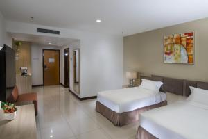 A room at One Pacific Hotel and Serviced Apartments