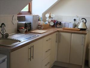 A kitchen or kitchenette at Woodway B&B
