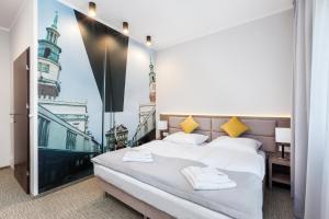 מיטה או מיטות בחדר ב-Meet Poznań Hotel