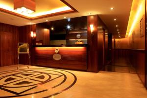 The lobby or reception area at Suhim Portico Hotel & Resort