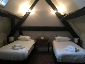 A bed or beds in a room at Risley Hall Hotel