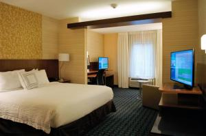 A television and/or entertainment center at Fairfield Inn & Suites by Marriott Stroudsburg Bartonsville/Poconos