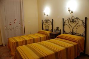 A bed or beds in a room at Villa de Xicar