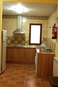 A kitchen or kitchenette at Villa de Xicar
