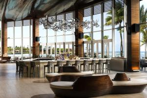 A restaurant or other place to eat at Caribe Hilton