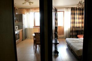 Кровать или кровати в номере Apartments on Kashirskoye sh, 32к2