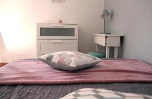 A bed or beds in a room at La Colombière - Montélimar
