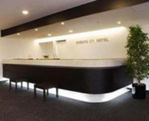 The lobby or reception area at Niigata City Hotel