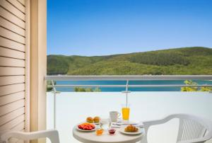 A balcony or terrace at Allegro Sunny Hotel by Valamar