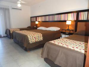 A bed or beds in a room at Munay Hotel Cafayate