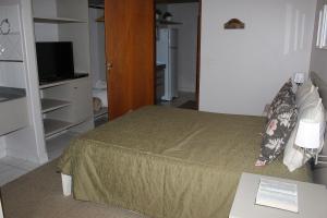 Una habitación en Pousada Canto do Sabiá - Pirenópolis