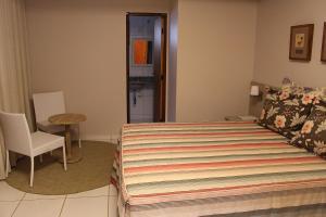 Cama o camas de una habitación en Pousada Canto do Sabiá - Pirenópolis