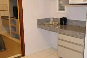 Una cocina o zona de cocina en Pousada Canto do Sabiá - Pirenópolis