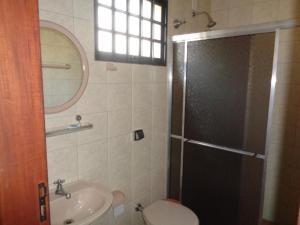 Um banheiro em Pousada Fazenda Buracão