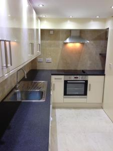 A kitchen or kitchenette at Hour Glass Hotel