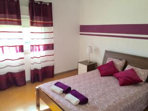 A bed or beds in a room at Oriente DNA Studios