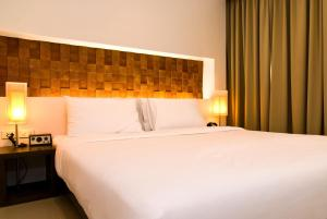 A bed or beds in a room at The Album Hotel